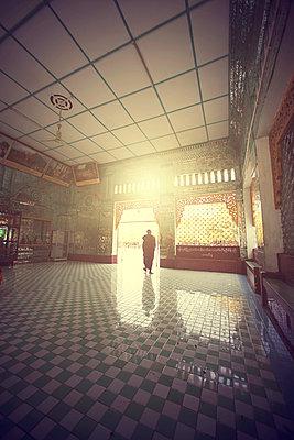 monk walks towards the temple door - p343m1107075 by Me Studio
