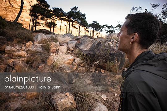 Hiker in rocky area - p1640m2261039 by Holly & John