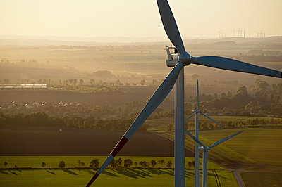 Evening at a wind farm - p1079m881322 by Ulrich Mertens