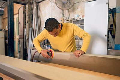 Carpenter working in workshop - p312m2207708 by Viktor Holm
