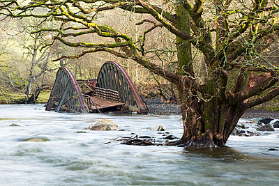 Railway bridge on the old Keswick railway line that were completely destroyed by flooding, Keswick, Cumbria, UK - p343m2028906 by Ashley Cooper