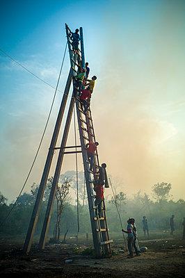 Contestants install their rocket on the launching ramp during Boun Bang Fai, aka Rocket Festival, Ban Don Nieng, a small village near Vientiane, Laos, Southeast Asia - p934m1177070 by Sebastien Loffler