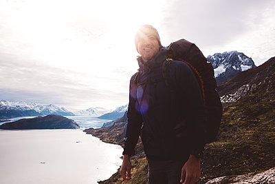 Happy traveler enjoying fantastic view of lake and mountains - p1166m2153581 by Cavan Images