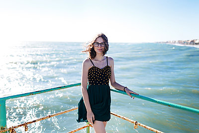 young girl in dress enjoying a vacation near the summer sea of Italy - p1166m2171797 by Cavan Images