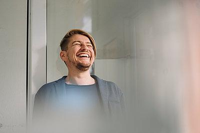 Portrait of laughing businessman - p300m2189067 by Joseffson