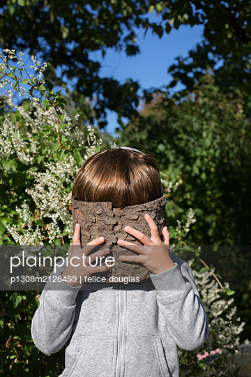 Hiding kid - p1308m2126459 by felice douglas