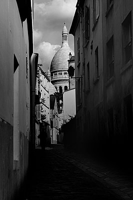 View of the Scare Coeur from an dark alleyway in Paris, France - p1072m2152507 by Neville Mountford-Hoare