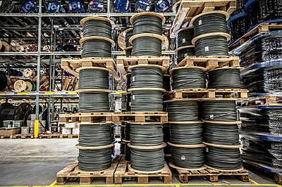 Cable drums stacked on pallets in warehouse - p429m803060f by Arno Masse