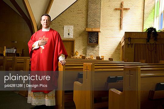 Catholic priest in a church