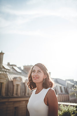 A woman on the roofs of Paris - p1150m1201646 by Elise Ortiou Campion