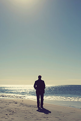 Man at beach - p1152m940142 by Susan Fox