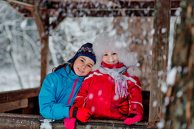 Portrait of two happy girls in winter clothes - p300m2277007 by Oxana Guryanova