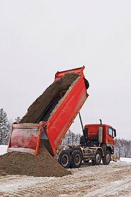 Dumper truck unloading - p390m1115653 by Frank Herfort