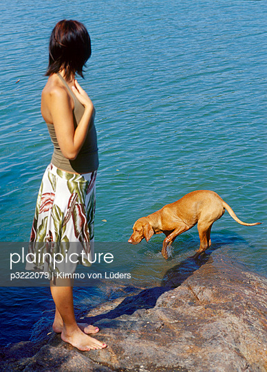 Woman and dog - p3222079 by Kimmo von Lüders