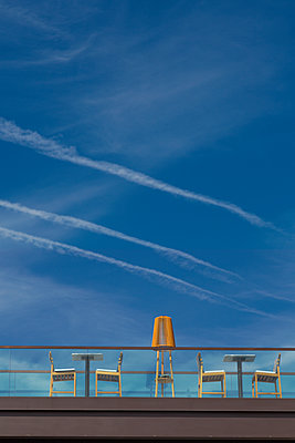 Cafeteria on a bridge, vapour trails in the sky - p1032m2182064 by Fuercho