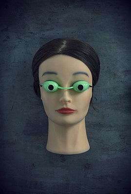 Head with UV eye shields glasses - p1028m1034255 by Jean Marmeisse