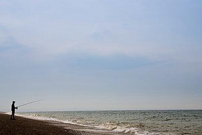 Man fishing on Cley Beach, Norfolk, United Kingdom - p871m837916 by Tim Graham