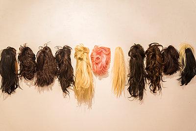 Wigs hanging on a wall - p1170m1044346 by Bjanka Kadic