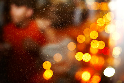 Blurred Couple and Colorful Light Reflection in Window - p694m663645 by Maria K