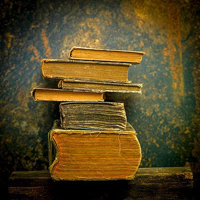 Old books stacked - p813m1424600 by B.Jaubert
