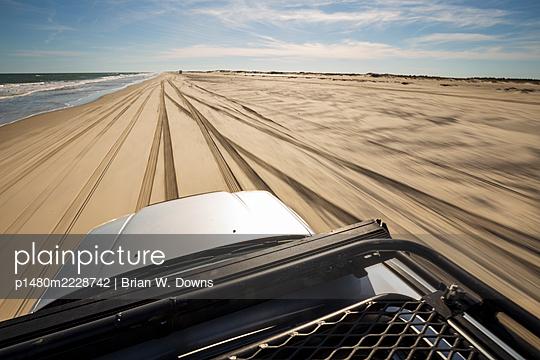 Driving on a beach in a SUV, Portsmouth Island, North Carolina - p1480m2228742 by Brian W. Downs
