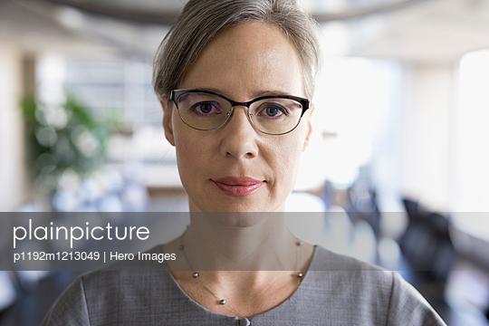 Close up portrait serious, confident businesswoman wearing eyeglasses