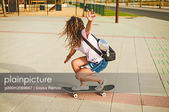 Girl with skateboard - p300m2069667 by Eloisa Ramos