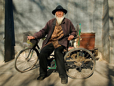 Chinese man with bike - p1125m943672 by jonlove