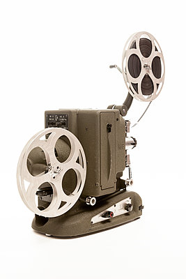 An old 16mm cine projector on a white background  - p1302m1148560 by Richard Nixon