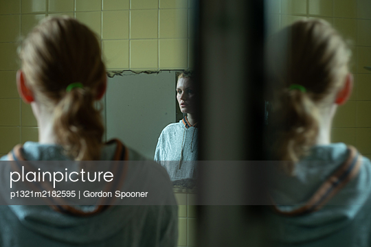 Woman in the mirror - p1321m2182595 by Gordon Spooner