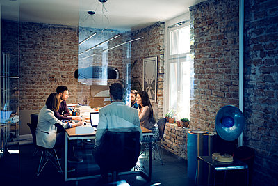 Business colleagues in meeting at conference table - p1166m1087874f by Lumina Images