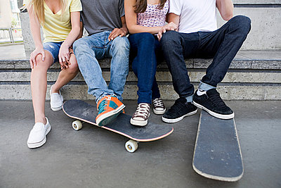 Teenagers with skateboards - p9246784f by Image Source