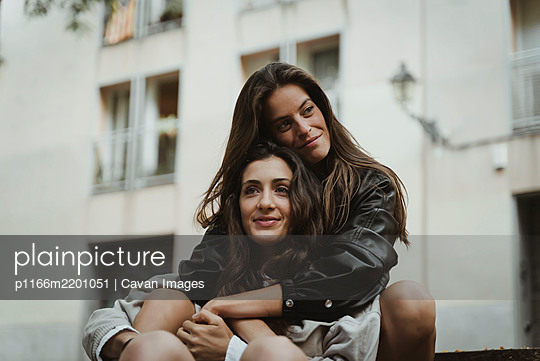 Attractive lesbian girls couple hug each other. LGBT - p1166m2201051 by Cavan Images