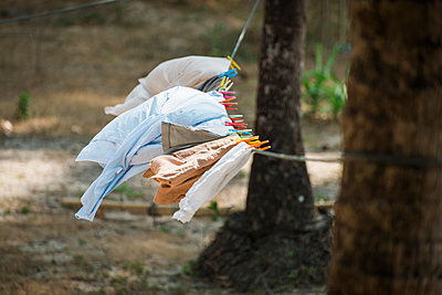 Washing on the line in the wind - p1437m1584891 by Achim Bunz