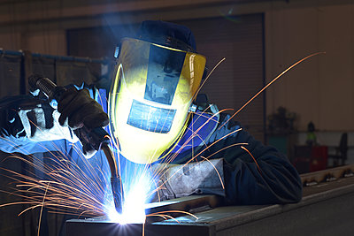 Welder at work in factory - p300m1581559 by lyzs