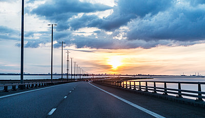 Road at sunset - p312m1139547 by Peter Rutherhagen