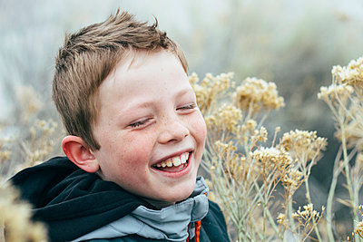 Laughing Boy with Freckles - p1262m1115683 by Maryanne Gobble