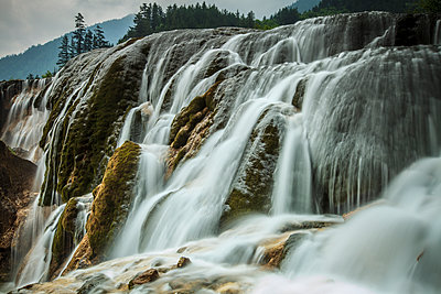 Waterfall in rural landscape,Jiuzhaigou, Sichuan, China - p1100m2084189 by Mint Images