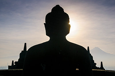 Indonesia, Java, Borobudur Temple Complex, sitting Buddha in backlight - p300m2081468 by Michael Runkel
