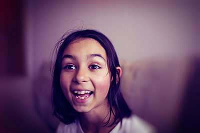 Mixed race girl laughing - p555m1421057 by Donald Iain Smith