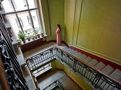 Woman in staircase - p390m1011415 by Frank Herfort