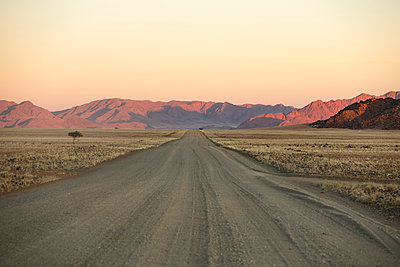 Road across the Namib Desert, Namibia, Africa - p871m1082256 by Neil Emmerson