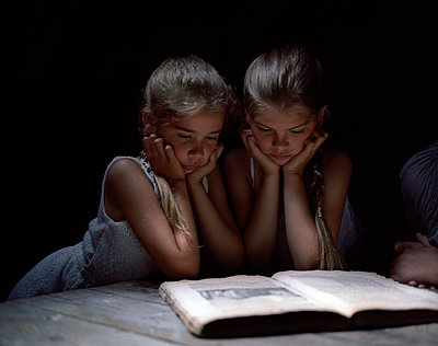 Two girls reading book of fairy tales - p945m1155031 by aurelia frey