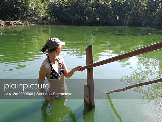Teenage girl in bikini in a forest lake - p1412m2200546 by Svetlana Shemeleva