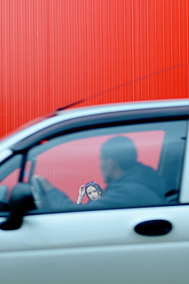 Man in a car and young woman  - p1412m2054335 by Svetlana Shemeleva