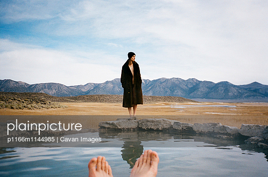 Woman looking away while standing on Mammoth Hot Springs against sky - p1166m1144985 by Cavan Images