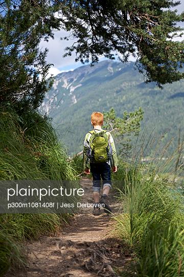 Austria, Tyrol, boy hiking at Achensee