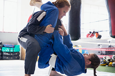 Determined women practicing judo in gym - p1023m1506462 by Sam Edwards