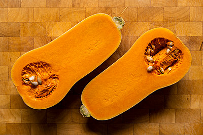 Butternut cut in half - p1655m2273320 by lindsay basson