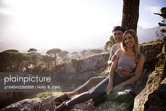 Young couple on a trip in mountain landscape - p1640m2260958 by Holly & John